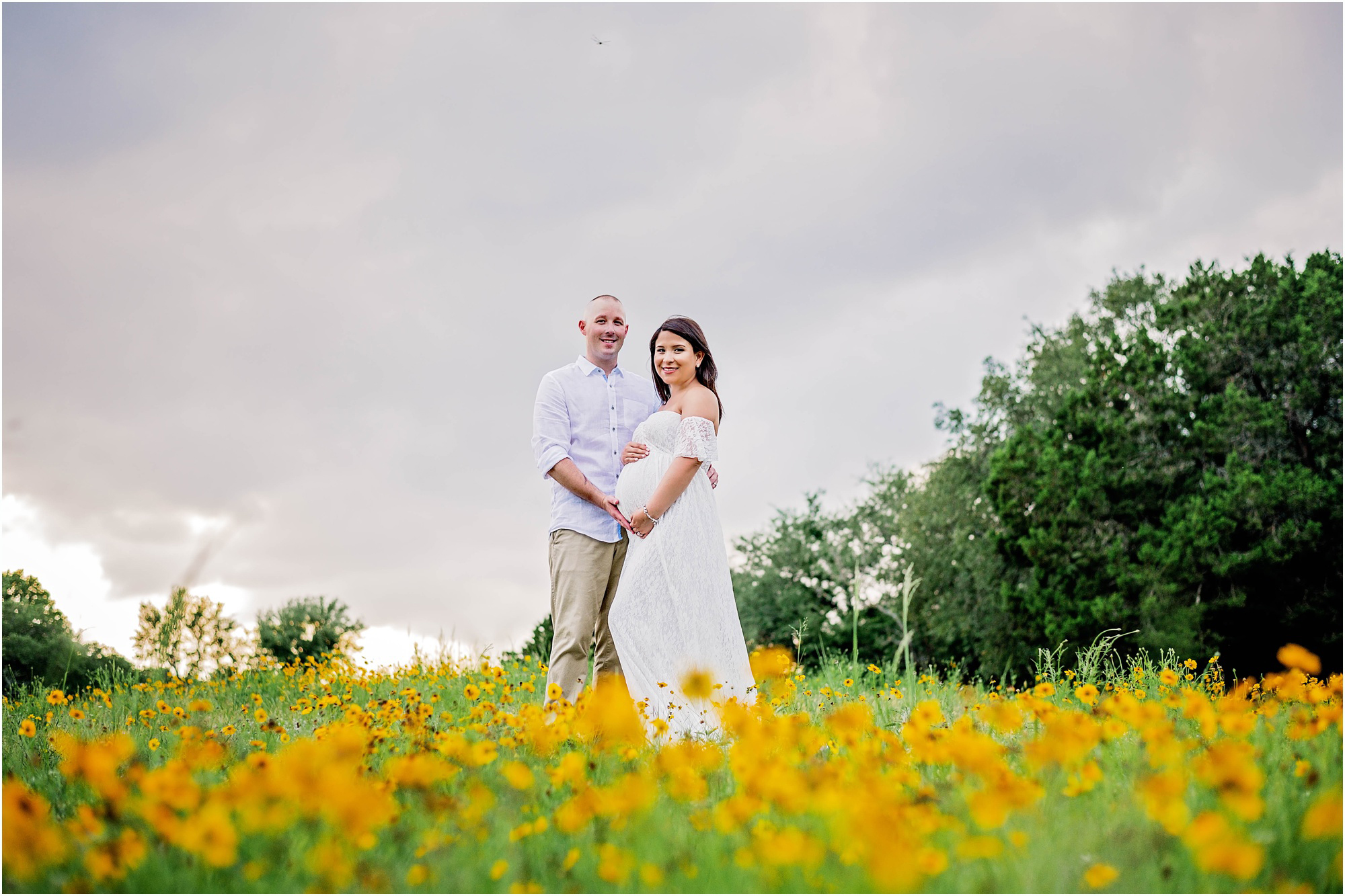 Maternity Photoshoot Of Couple In Beautiful Yellow Flower Field Cedar Park Texas Photographer Maegan Kylie Photography